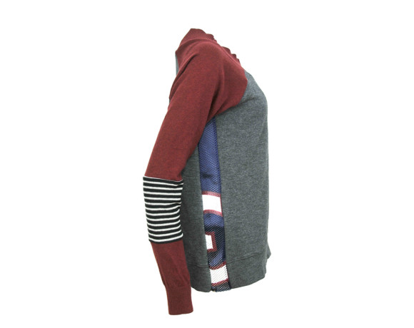 Maroon sleeve, zebra striped elbow soft raglan sweater with mesh side panels. Size large.