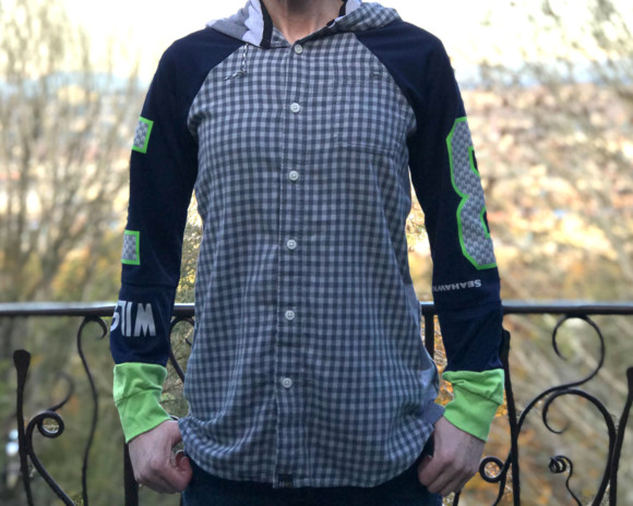 (SOLD) Blue, green and gray plaid raglan hoodie with Seahawks jersey sleeves. Size medium.